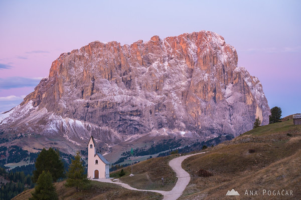 Chapel at Passo Gardena with Sasso Lungo in the background at sunrise