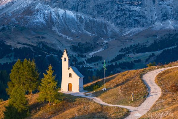 Chapel at Passo Gardena with Sasso Lungo in the background after sunrise