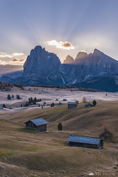 First sun rays from behind Sasso Lungo as seen from Alpe di Siusi