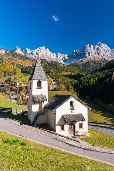 San Cipriano church and Torri del Vajolet in the background