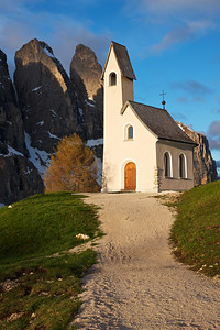 Path of God The gravel walkway leading to this high-mountian church and the distant peaks in the background amazed me.  I love the beauty of the Dolomites.