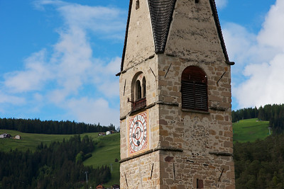 San Martino Clock Tower stands above a lovely village in Alta Badia, Dolomites, Italy
