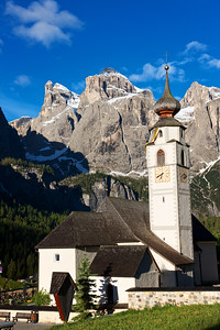 Corvara Church, Sella Mountains at sunrise.  The beautiful church tower and high mountains were amazing.