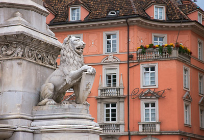 Bolzano Town Square is known as Walther Plaza.  Here a lion statue stands guard and a trendy hotel lays in the background.