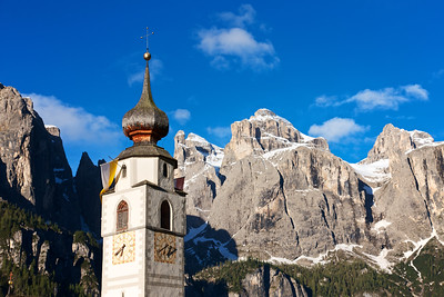 Dolomite Domes Church with snow-covered mountain peaks