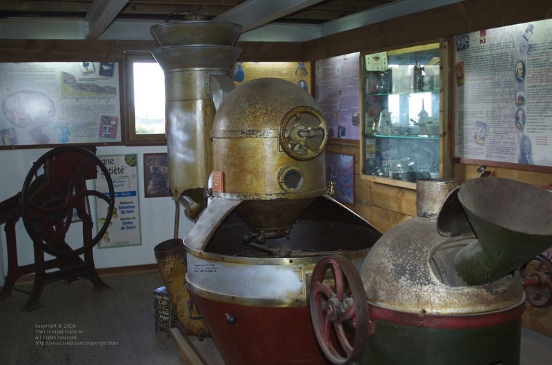 The museum had several old grinders and roasters from the days when power came from a steam engine and belts.