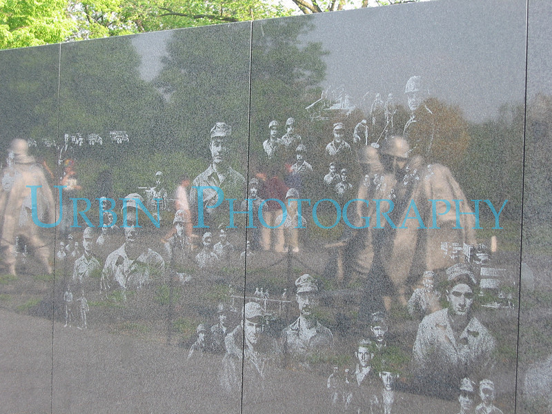 Opposite the more famous Vietnam War Memorial Wall is the Korean War Memorial Wall.  Etched on the wall are images from the Korean War. The statues reflected in the wall are also part of the memorial.