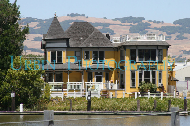 The River House. A bright yellow building in Petaluma, CA.