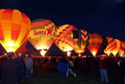 Albuquerque, NM - The balloons' propane burners lit up the horizon.  The pilots are in contact with each other, so in a synchronized light show, the balloons all glow at once.