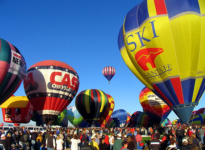 Then, in the early morning, beneath a crystal clear, blue New Mexico sky, the first balloons freed themselves from their earthly moorings and began to ascend.