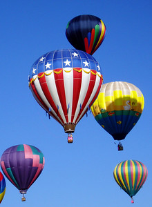 ....as balloons of all colors took to the air, some with a patriotic theme....