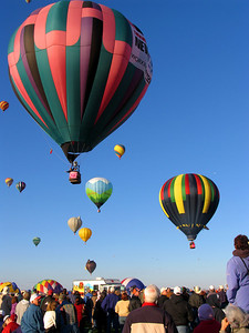 .... and by mid-morning, the Mass Ascension was underway in full force.  From its modest beginnings in 1972 with 13 balloons launching from a shopping mall parking lot, the Albuquerque Balloon Fiesta now features nearly 700 balloons rising from a 365-acre park.