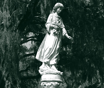 "Hours could be spent walking through the Bonaventure Cemetery's labyrinth of dusty paths, all the while being ""observed"" by exquisitely-carved marble figures looking down from their pedestals."