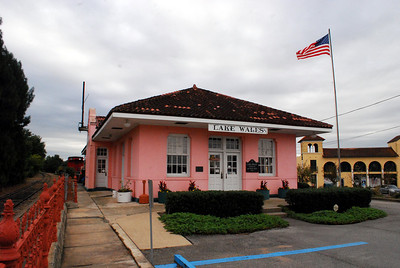 """The peach-tinted Atlantic Coast Line (ACL) Railroad Depot, now the Lake Wales Depot Museum, is a reminder of the railroad that remains from the town's historic period. Its completion in 1928 marked the end of 1920s """"Boom Time"""" development in Lake Wales."""