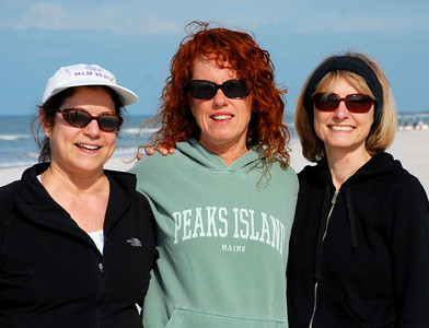 Nancy, Maureen, and Jeanne -- clad in sweatshirts perhaps, but glad to be outdoors on the beach in the morning sun.