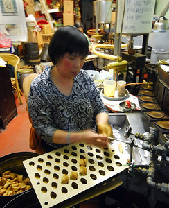 We turned into Ross Alley off Jackson Street and followed our nose to the Golden Gate Fortune Cookie Company where we sampled a freshly baked wafer while watching a woman fold cookies around fortunes at a remarkable rate.