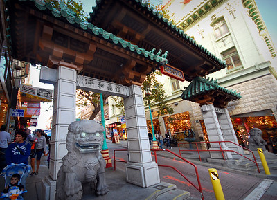 Traditional fou dogs stand guard at the sides of the ceremonial gateway, designed by architect Clayton Lee in 1970.