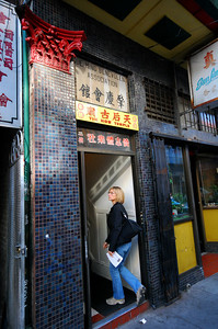 """About halfway down Waverly Place in San Francisco's Chinatown, we found a little yellow sign reading """"Tin How Temple."""" Three flights of stairs up, we entered the oldest Chinese temple in the U.S. (founded in 1852).  No photos of the temple's interior were allowed."""