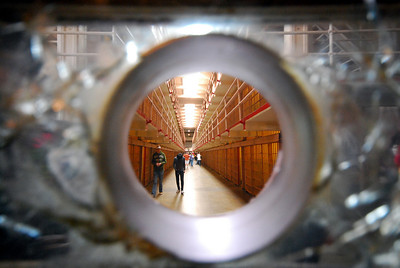 LOOKING IN... Guards could use this hole in 4-inch thick glass as a rifle port in the event of a disturbance in the cellblocks.  Guards were not permitted to wear weapons inside the cellblocks.