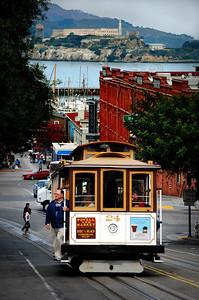 Okay, so San Francisco isn't the easiest city to walk.  It's vertical -- all up and down.  Mostly up, it seemed to us.  Its iconic cable cars - like this one on Hyde Street -- offer a way to traverse its steep hills should your feet fail you.  Notice the island of Alcatraz in the background.