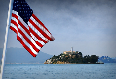 """After a full morning spent exploring America's most famous prison, we caught the ferry back to the mainland.  From the back of the ferry, our final view of """"The Rock"""" ... a place with a grim past that continues to fascinate ... once a symbol of isolation, today one of San Francisco's most prominent and visited landmarks."""