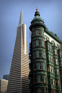 """....its modern design contrasting sharply with the nearby """"skyscraper"""" of an earlier era:  the historic Sentinel building.  At the time of the earthquake of 1906, the steel frame building was under construction and it survived the fire. Today it belongs to film director Francis Ford Coppola."""