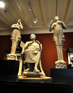 In this nearly life-sized sculpture, probably carved around 300 BC, a seated man is flanked by sirens, creatures part bird and part woman. The man once cradled a lyre in his left arm and might be Orpheus, who was famous for his singing.