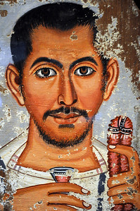 Once fitted into the wrappings of an Egyptian mummy, this tempera painting on wood dates back to AD 220-250 and probably depicts a Roman who had lived - and died - in Egypt at that time.