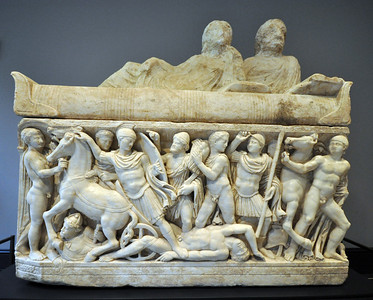An episode from the life of the Greek hero Achilles decorates the side of this Roman sarcophagus, dating from around 200 AD. On the lid, a man and a woman recline on an upholstered couch. As was the common practice, the heads of the figures were left unfinished so they could be carved as portraits of the deceased when the sarcophagus was purchased. In this instance, however, the portraits were never completed.