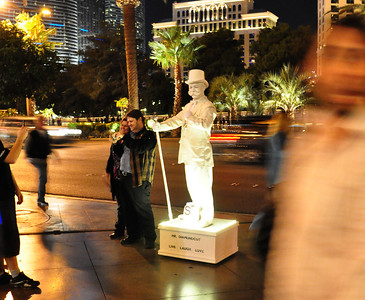 Street performers stood out in the glaring brilliance of the nighttime Strip.