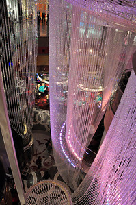 The cavernous interiors of the big casinos create the illusion of an opulent world of multi-story cascading chandeliers....