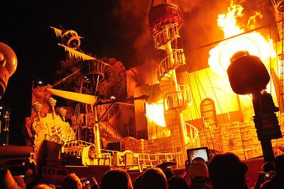 "...and their renegade pirate ship goes down in a brilliant finale of flame. Admittedly, it's not great drama, but as the show's creator says, the Sirens of TI is ""light and whimsical, very appropriate for street theater."""