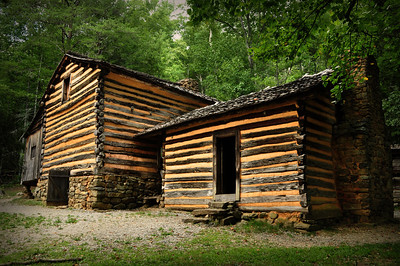 "Elijah's new home reflected the latest style in Tennessee backwoods cabins -- the ""dogtrot"" design, two log cabins connected by a breezeway or ""dogtrot"" (the design was also sometimes referred to as ""possum trots"")."