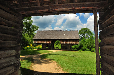 "The double-cantilever barn at the Tipton Place, built in the 1880s by the descendants of Revolutionary War veteran William ""Fighting Billy"" Tipton.  Unique to eastern Tennessee, this style of barn has considerable overhang, allowing livestock shelter in inclement weather."