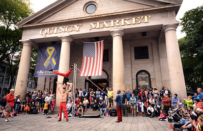 For more than two centuries, Quincy Market, adjacent to Faneuil Hall, has been one of the social centers of life in Boston.  Built in 1742 as a wholesale market, the building quickly became a gathering place for crowds to hear the anti-England rhetoric from patriots like Sam Adams.  Today it is still a popular place for performances of a different type.