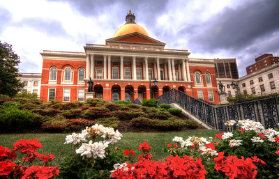 "The Massachusetts State House, also known as the ""New"" State House, is the state capitol and seat of government for the Commonwealth of Massachusetts. Built in 1798, it stands on the former cow pasture of Declaration of Independence signer (and Massachusetts first elected governor) John Hancock.  The golden dome, its most distinct feature, once made of wood was later overlaid with copper by Paul Revere. It was covered with 23 karat gold leaf for the first time in 1874 and painted black during World War II to protect the city from bombing attacks."