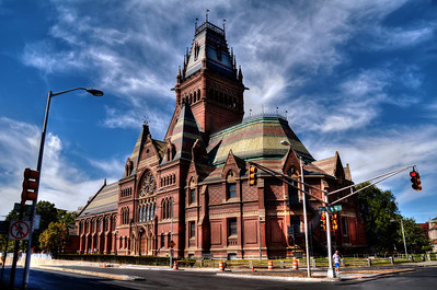 """We traveled to the Cambridge suburb of Boston to visit Harvard University where its most imposing building is Memorial Hall, just north of the Harvard Yard.  It was built immediately following the Civil War to honor Harvard men who had fought for the Union. Designed as an ornate Gothic Revival structure, it is 5,000 square feet of stained glass, a 210-foot tower, intricate slate roofing, and gargoyles sheathed with copper. One critic later called it an """"impossible conglomerate of mutations."""""""