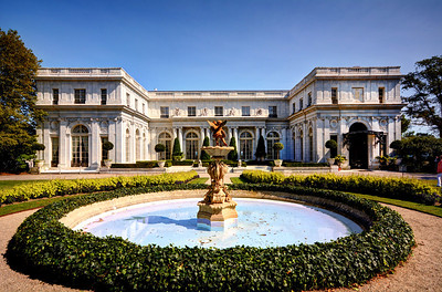 """Commissioned in 1899  by Nevada silver heiress Theresa Fair Oelrichs - known as """"Tessie"""" to her friends - Rosecliff was modeled after the Grand Trianon, the garden retreat of French kings at Versailles. After the house was completed in 1902, at a reported cost of $2.5 million, Mrs. Oelrichs hosted fabulous entertainments here, including a party featuring famed magician Harry Houdini."""