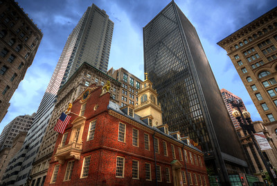 The Old State House - Nestled in the shadows of the modern Financial District, this was the center of Boston 's civic life in the 18th century and the scene of some of the most dramatic chapters in the lead-up to the American Revolution. Within these walls, Samuel Adams, John Hancock, and John Adams debated the future of the British colonies.