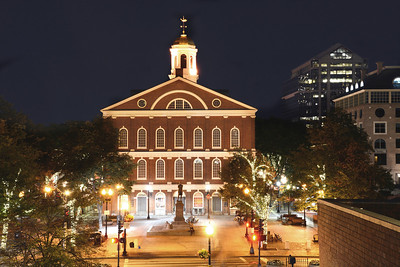 """Boston's historic buildings take on a special glow in the evening.  Faneuil Hall has been a marketplace and meeting spot for over 250 years. Bordered by the waterfront, Government Center, Haymarket and the North End, the neighborhood is known for its huge shopping area, sidewalk performances during the summer, and a well-traveled part of Boston's """"Freedom Trail."""""""
