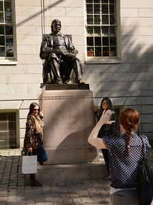"""The John Harvard statue is a mainstay of Harvard Yard, and some claim it is the most photographed statue in the area.  But the statue is not really what it seems.  Its nickname is the """"statue of three lies"""" because ... (see the next photo)"""