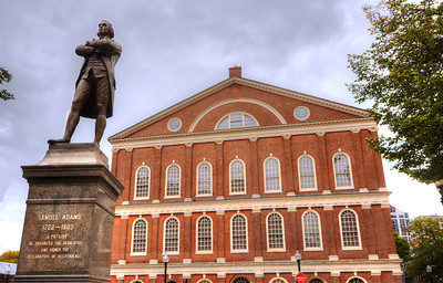 """The statue of Samuel Adams in front of Faneuil Hall could not be better placed, for it was here that he did his greatest work, dominating town meetings and staging a funeral for the victims of the Boston Massacre.  It was at Faneuil Hall in 1764 that Americans first protested against the Sugar Act and the Stamp Act, setting the doctrine that would come to be known as """"no taxation without representation."""""""