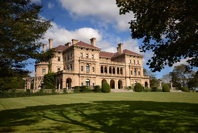 """The Breakers is the grandest of Newport's summer """"cottages.""""  In 1893 Cornelius Vanderbilt II, grandson of Commodore Cornelius Vanderbilt who had established the family fortune, commissioned architect Richard Morris Hunt to design a villa to replace an earlier wood-framed house which had been destroyed by fire the previous year."""