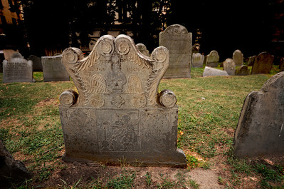 King's Chapel Burying Ground was founded in 1630 as the first cemetery in the city of Boston. Most notable about this historic cemetery is Joseph Tapping's stone where a skeleton and Father Time battle over the eventuality of death.  Many believe it to be Boston's most beautiful headstone!