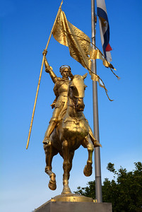 Nearby is the golden bronze statue of Joan of Arc.  The people of France gave the statue to the City of New Orleans in 1972. The inscription on the pedestal reads:  JOAN OF ARC, MAID OF ORLEANS, 1412 - 1431, Gift of the People of France.