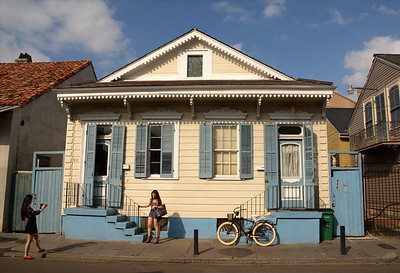 """Quite a departure from the ornate buildings of the French Quarter, this typical """"shotgun"""" duplex stands within a block or so of the city's historic commercial center.  The term """"shotgun"""" comes from the fact that a shotgun fired through the front door(s) would shoot directly through the back doors."""