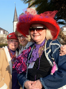 """Although Mardi Gras was over, it didn't deter members of the """"Red Hat Club"""" from Lubbock, Texas, from donning their distinctive headware during their visit to Jackson Square."""