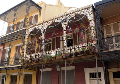 One of the most elaborate balconies decorating the second-story home of a French Quarter resident.
