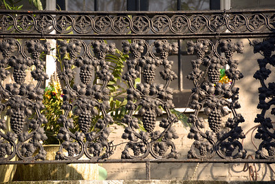 Ironwork is so associated with New Orleans that it may come as a surprise to some that wrought iron (worked by hand) and later cast iron are Victorian additions, adapted from a Spanish influence, and not original to the oldest masonry townhouses which originally had wooden railings.