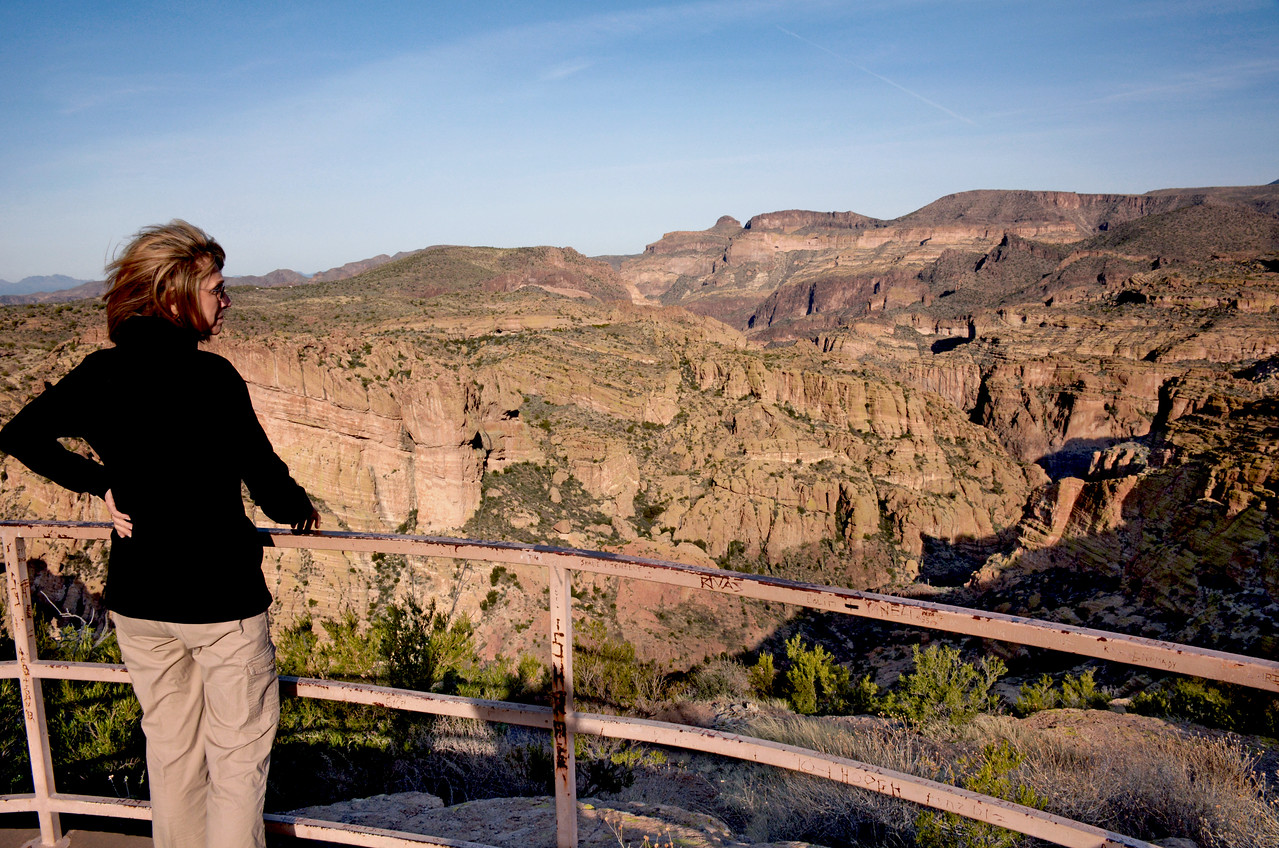 From the top of Fish Creek Hill, Jeanne looks out over the region's rugged canyons. From this point, a one-lane, cliff-hanging road descends more than 1,000 feet, the most scenic  — and adventurous  —  portion of this drive.